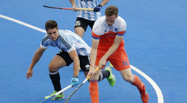 Mirco Pruijser (right) scored twice as Holland booked their place in the final of the EuroHockey Championships in Amsterdam