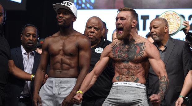 Floyd Mayweather and Conor McGregor during the weigh in