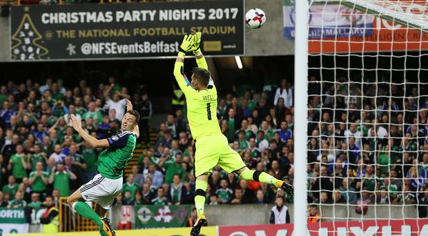 Jonny Evans heads in the opening goal