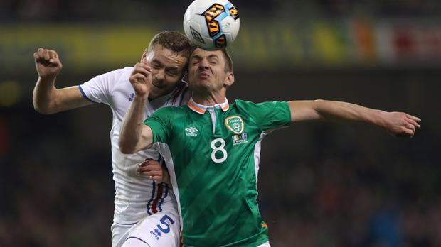 Former Ireland striker Kevin Doyle (right) retired because of concerns over concussion