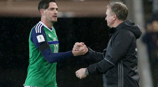 Kyle Lafferty, left, was entrusted with a start