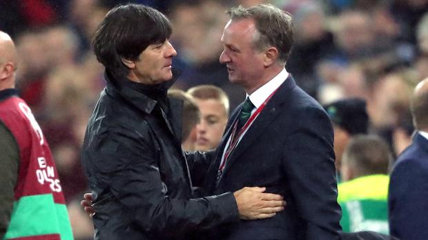 Northern Ireland manager Michael O'Neill (right) and Germany manager Joachim Low embrace