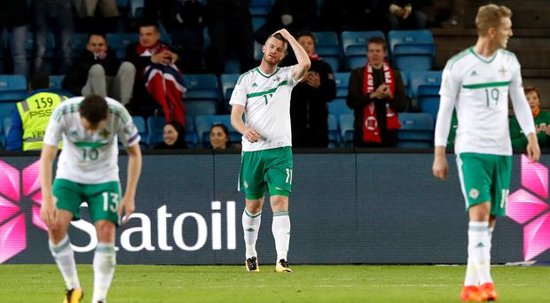 Chris Brunt reacts after scoring an own goal for Northern Ireland
