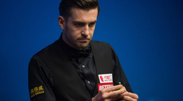 World number one Mark Selby came from behind to beat Scott Donaldson at the English Open in Barnsley