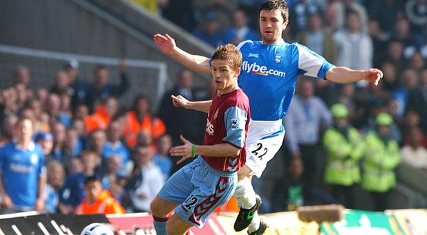 Steven Davis, left, and Damien Johnson were international colleagues in midfield for five years