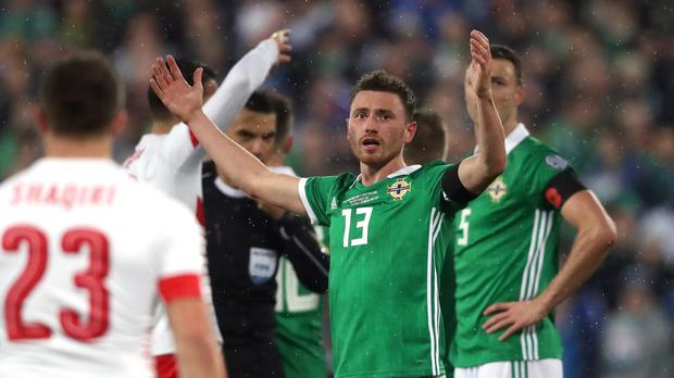 Corry Evans, centre, reacts in disbelief after being penalised for handball