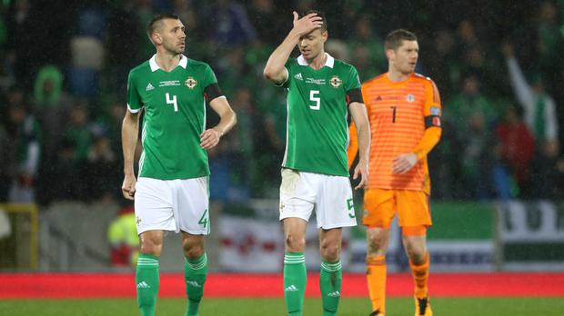 Jonny Evans, centre, could not hide his frustration after defeat to Switzerland