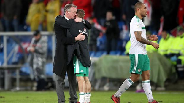 Michael O'Neill, left, embraces Jamie Ward after the match