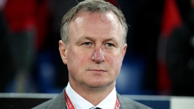 Edinburgh-based Northern Ireland manager Michael O'Neill has been approached by Scotland