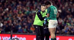 Ireland's Joey Carbery receives treatment for an injury during the 23-20 win against Fiji