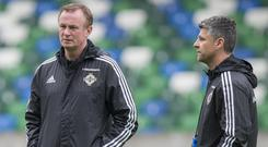Stephen Robinson, right, is keen for Michael O'Neill to stay as Northern Ireland manager