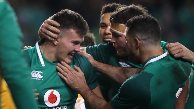 Jacob Stockdale, left, is congratulated after his opening try