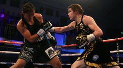 Katie Taylor, right, retained her WBA lightweight title with victory over Jessica McCaskill