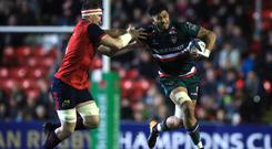 Leicester's Sione Kalamafoni, right, and Munster's CJ Stander battle for possession