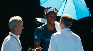 Gael Monfils speaks to an official during his match against Novak Djokovic. Photo: Reuters