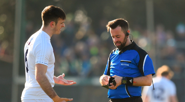 Eoin Doyle of Kildare appeals to referee David Gough