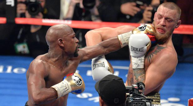 Floyd Mayweather stopped Conor McGregor is a boxing match last year