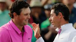 Patrick Reed, left, is congratulated by Rory McIlroy after winning the Masters. Photo: PA