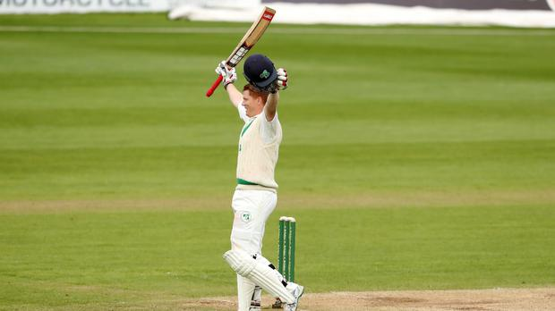 Kevin O'Brien celebrates reaching his ton (Niall Carson/PA)