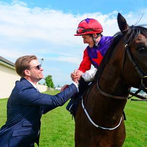 Romanised and jockey Shane Foley are greeted by winning trainer Ken Condon after winning the Tattersalls Irish 2000 Guineas Photo: PA