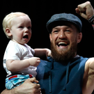 Conor McGregor holds his son Conor Jack McGregor Jnr before an open workout in Las Vegas. Photo: AP