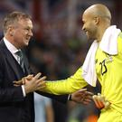 Republic of Ireland keeper Darren Randolph is congratulated by Northern Ireland manager Michael O'Neill (Lorraine O'Sullivan/PA)