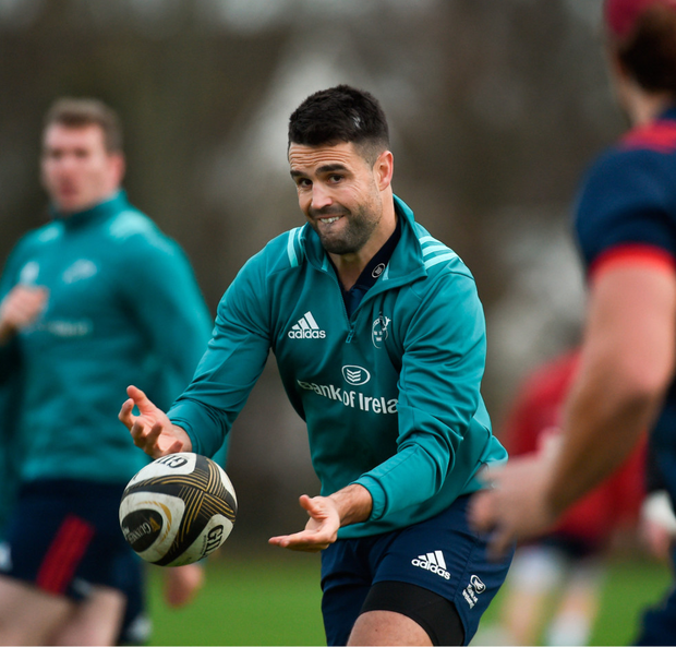 Conor Murray gives a pass to Arno Botha during Munster training in Limerick earlier this week. Photo: Diarmuid Greene/Sportsfile