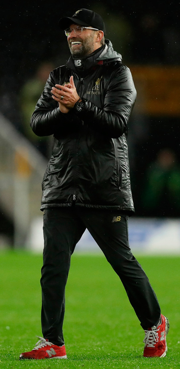 Jurgen Klopp applauds his players after their victory at Molineux