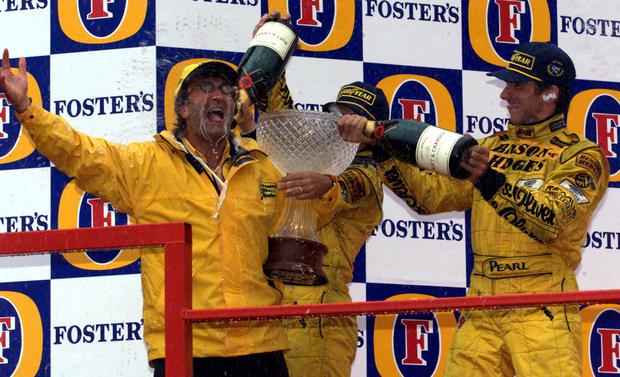 Eddie Jordan celebrates a 1-2 at the Belgian Grand Prix in 1998. Photo: Reuters