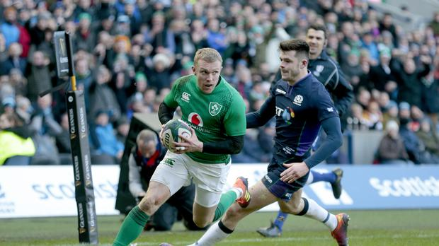 Keith Earls goes over for Ireland's third try against Scotland (Graham Stuart/PA)