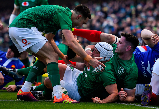 Rory Best is swamped by Ireland team-mates Conor Murray and James Ryan after scoring Ireland's first try against France. Photo: Sportsfile