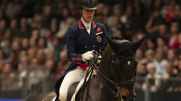 Charlotte Dujardin is eliminated from the whole championship (Steve Parsons/PA)