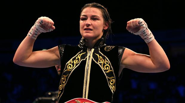 Katie Taylor celebrated a hard-fought victory in Manchester (Richard Sellers/PA)
