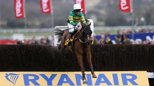 Uxizandre ridden by Tony McCoy jumps the last fence on his way to winning the Ryanair Chase