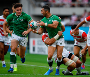Irish full-back Rob Kearney releases possession as he is tackled by Japan's Pieter Labuschagne. Photo: Brendan Moran/Sportsfile