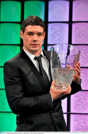 Darren O'Dea accepts his Young International Player of the Year award in 2012