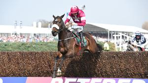Clarcam clears the final fence to win the Manifesto Novices' Chase at Aintree