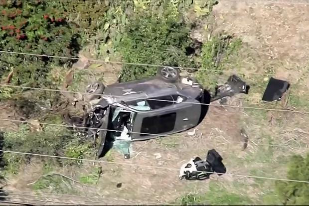 The vehicle of golfer Tiger Woods, who was rushed to hospital after suffering multiple injuries, lies on its side after being involved in a single-vehicle accident in Los Angeles, California