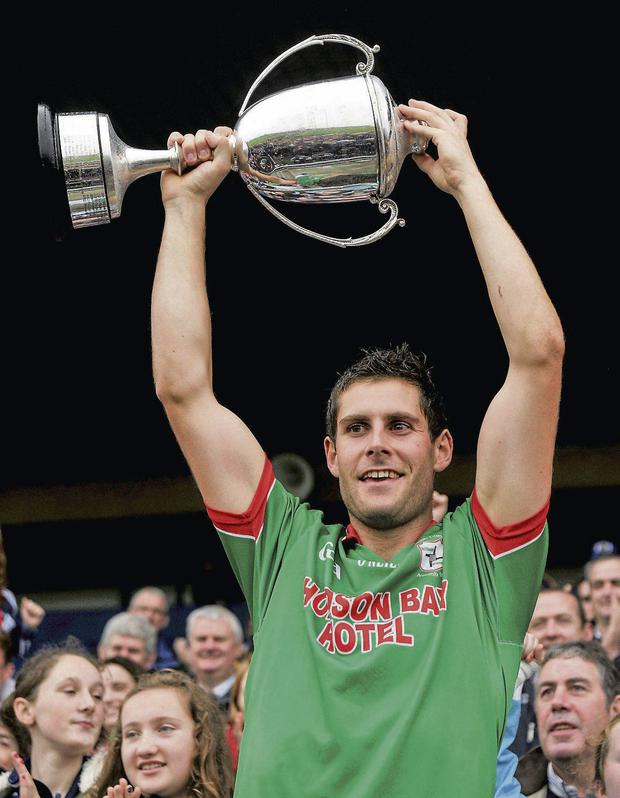 St Brigid's captain Niall Grehan lifts the JJ Fahey Cup at Dr Hyde Park