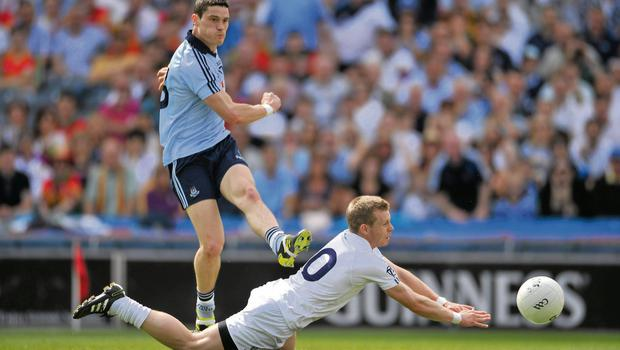 Diarmuid Connolly shoots on goal for Dublin despite the efforts of Kildare's Morgan O'Flaherty during the last Championship meeting between the counties in 2011