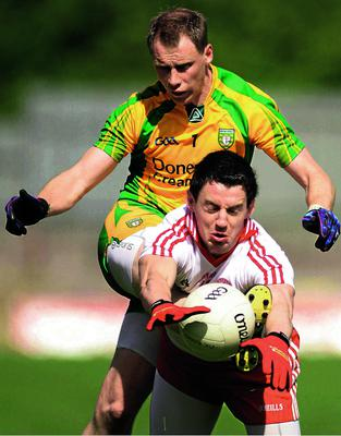 30 June 2012; Anthony Thompson, Donegal, in action against Matthew Donnelly, Tyrone. Ulster GAA Football Senior Championship Semi-Final, Tyrone v Donegal, St Tiernach's Park, Clones, Co. Monaghan. Picture credit: Oliver McVeigh / SPORTSFILE