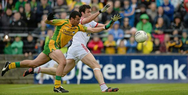 Frank McGlynn and Joe McMahon have eyes only for the ball as they battle it out at MacCumhaill Park