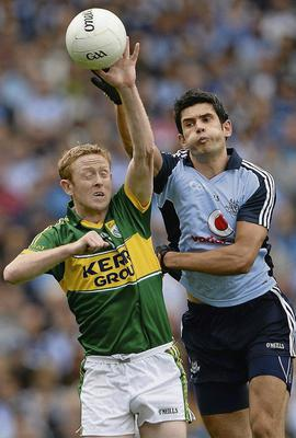 Colm Cooper, Kerry, in action against Cian O'Sullivan, Dublin
