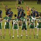Ireland's players watch their Australian opponents perform their pre-match 'War Cry' in Cavan before the start of the first half of the opening International Rules test