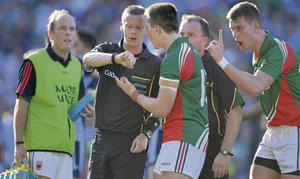 Mayo's Cillian O'Connor and Barry Moran confront referee Joe McQuillan as he looks at his watch after the final whistle was blown at Croke Park at the end of the All-Ireland final