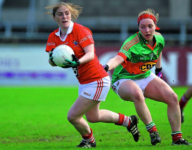 Cork's Rhona Ní Bhuachulla in action against Leona Ryder of Mayo during the Tesco HomeGrown Ladies NFL Division 1 final