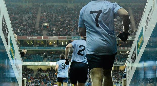 The Dublin team run out for a night time league game at Croke Park. The National League may be the ideal competition to trial Friday night games, when the stakes are not as high