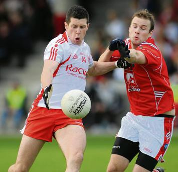 Tyrone's Sean Cavanagh takes on Mick Fanning of Louth during their first round qualifier in 2008. Tyrone will again be hoping that they can launch a challenge for Sam Maguire from the first round of back door games as they did five years ago