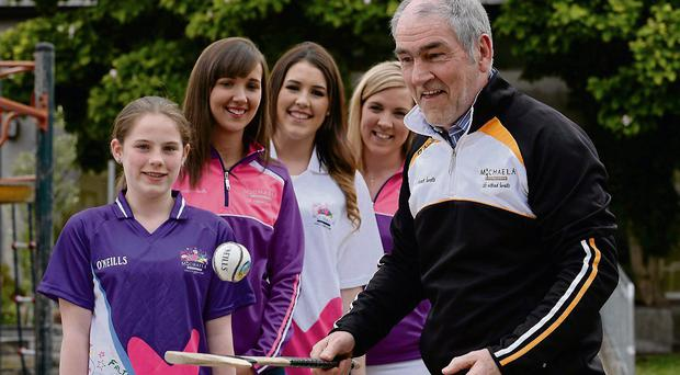Tyrone manager Mickey Harte demonstrates his hurling skills