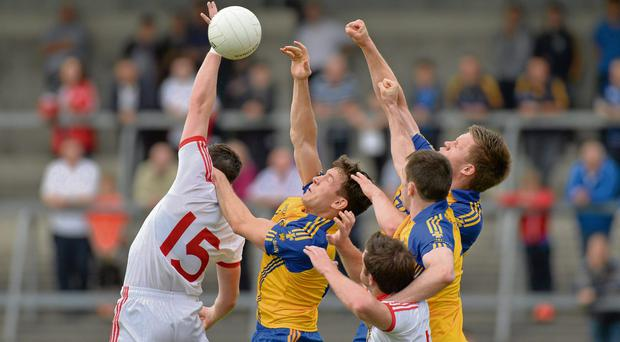 Neil Collins, Niall Carthy and Niall Daly of Roscommon battle with Tyrone's Conor McAliskey and Martin Penrose for the ball